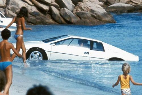 car emerging on beach